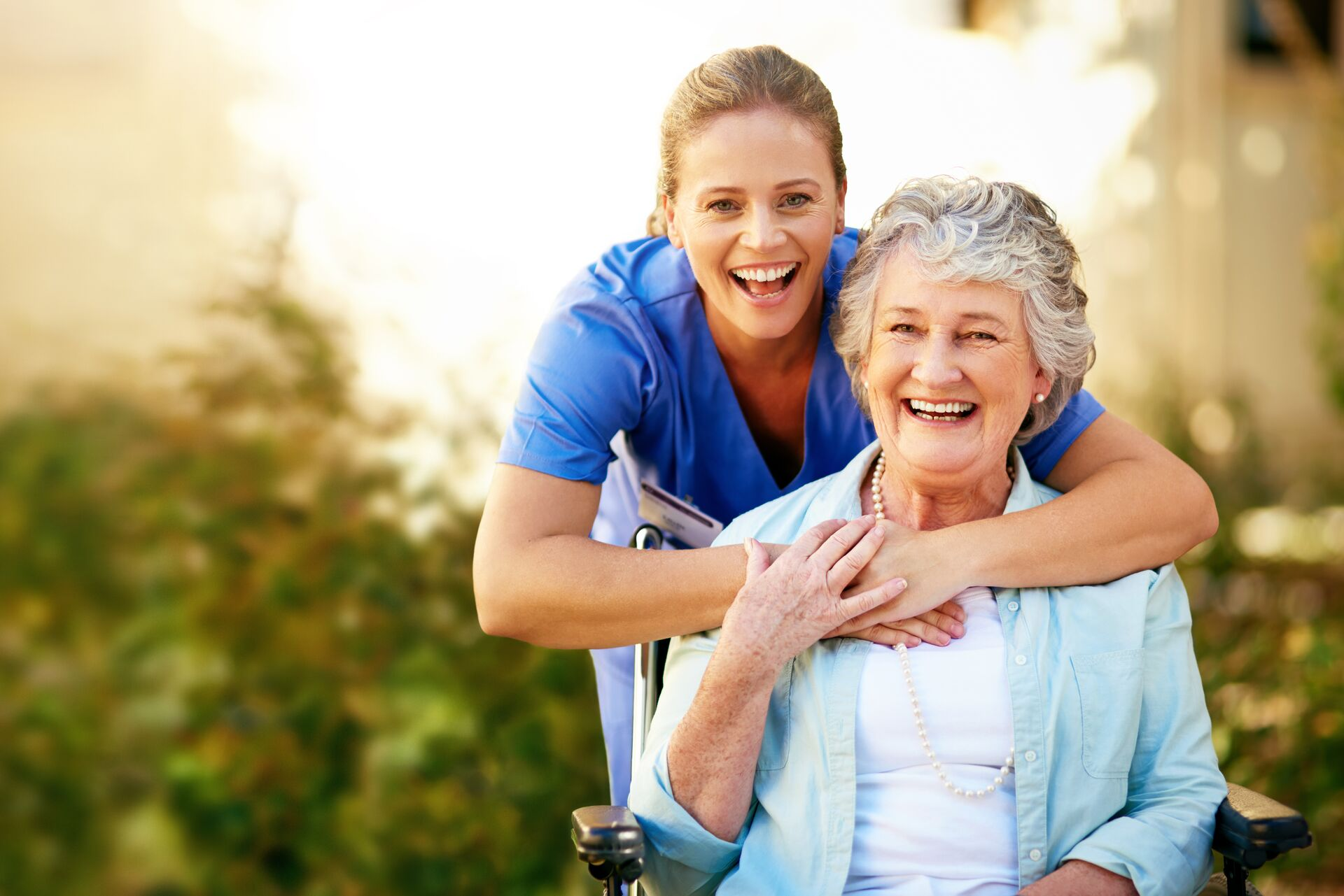 senior lady smiling with a nurse