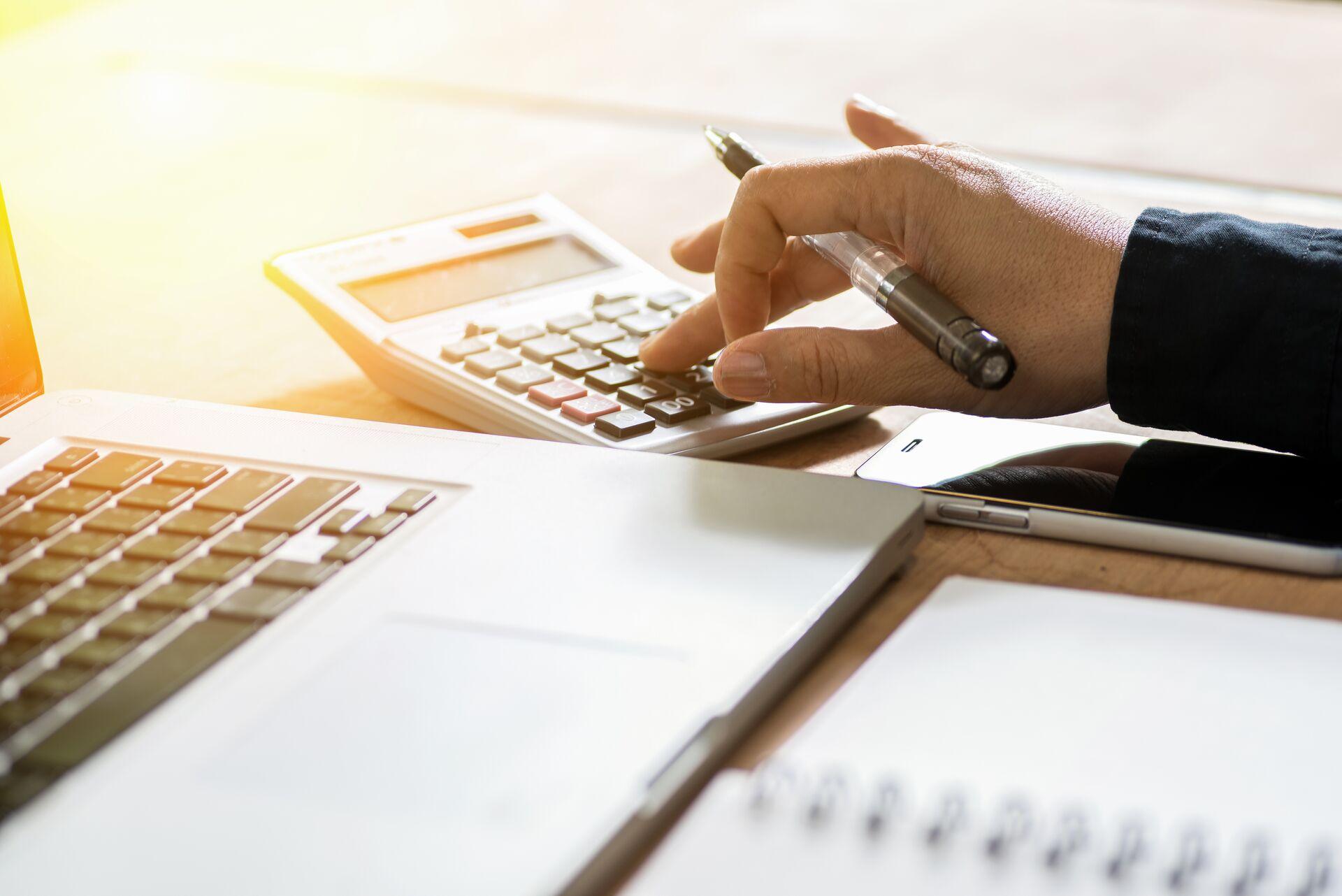 senior calculating the cost of senior living using a calculator