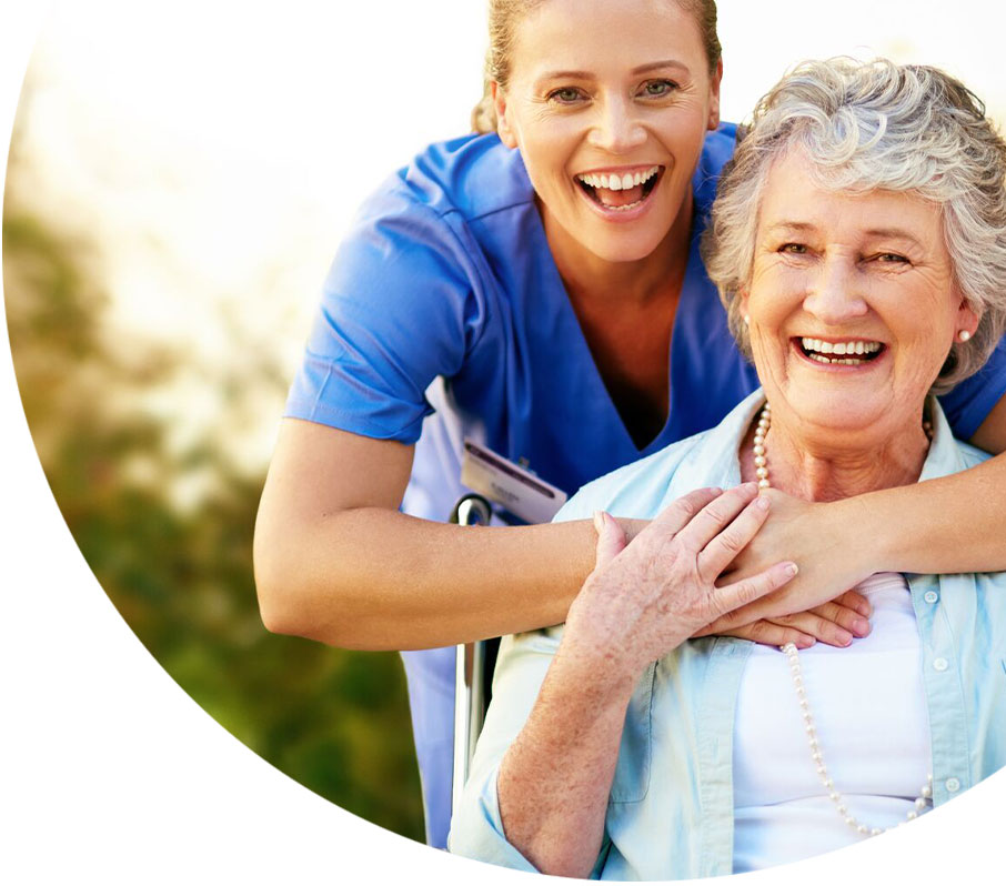 senior lady smiling with a caregiver outside a retirement community